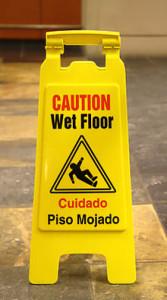 220px-Wet_floor_-_piso_mojado